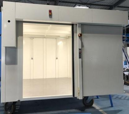 One-piece radiation protection cabinet - 10mm lead; 4m x 3m x 2.6m; Weight 16 tonnes.