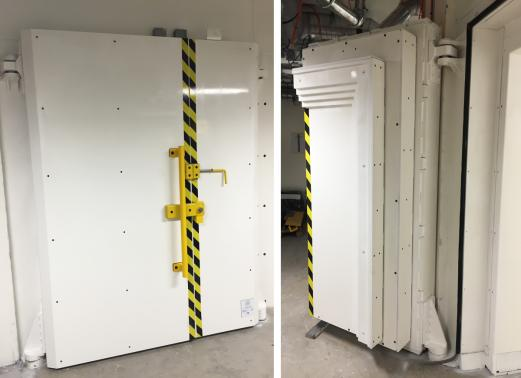 CERN - Geneva - Switzerland - 400 mm thick steel wall with manually operated double door. Total weight 37 tons.