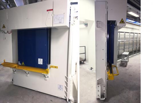 CERN - Geneva - Switzerland - 250 mm thick steel swing door with 150 mm lead motorised hatch. Total weight 9.5 t.