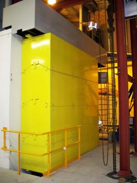 Diamond Light Source - Didcot - England - Door made of steel caissons filled with concrete; Thickness 1m; Weight 40tonnes.