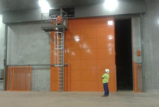 USA - X-ray bunker door for mining vehicle tyre. 5.0m x 6.0m high; Lead 8mm; Weight 6 tonnes.